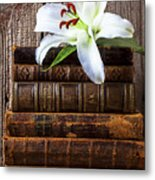 White Lily On Antique Books Metal Print