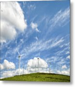 Wind Turbines On A Hill Under A Blue Sky Metal Print