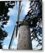 Windmill Through The Trees Metal Print