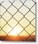Wire Mesh Fence On A Sunset Background Metal Print