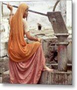 Woman At The Pump Metal Print