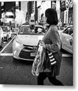 woman crossing crosswalk in front of yellow cabs in the evening in Times Square New York City USA Metal Print