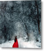 Woman In Red Cape Walking In Snowy Woods Metal Print