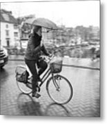 Woman Riding In The Raing Metal Print