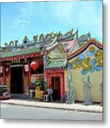 Woman Sits Outside Chinese Temple With Urn And Deity Statues Pattani Thailand Metal Print