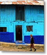Woman Walking By The Blue House Metal Print