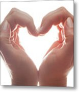 Woman's Hands Make A Heart Shape On White Background, Backlight. Love Metal Print