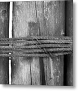 Wood Pilings Tied With Old Rusted Rope Metal Print