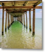 Wooden Pier Stretching Into The Sea Metal Print