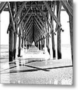 Wooden Post Under A Pier On The Beach Metal Print