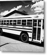 yellow american bluebird school bus in Lynchburg tennessee usa Metal Print by Joe Fox