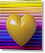 Yellow Heart On Row Of Colored Pencils Metal Print