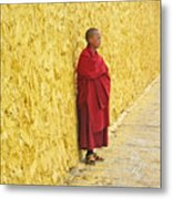 Young Monk Against Yellow Wall Metal Print