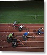 Paraplegic Athletes Racing Along Sports Track In Night Metal Print