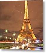 The Eiffel Tower Lit Up At Night In Metal Print
