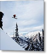 A Athletic Skier Jumping Off A Cliff In Metal Print