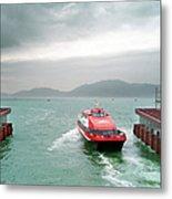 A Catamaran Ferry Docks At A Port Metal Print
