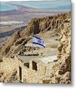 An Israeli Flag Flies Near The Entrance To The Top Of Masada In  Metal Print
