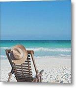 Beach Chair With A Hat On An Empty Beach Metal Print