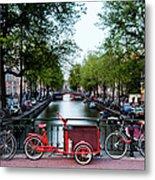 Bicycles Parked On Bridge Over Metal Print