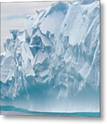 Blue Iceberg Carved By Waves Floats In Metal Print