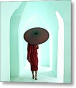 Buddhist Monk Walking Along Arched Metal Print