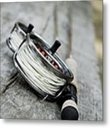Close-up Of Two Fishing Reels And A Metal Print