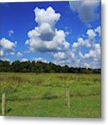 Clouds Surround The Landscape Metal Print