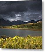 Dark Storm Clouds Hang Over The Metal Print
