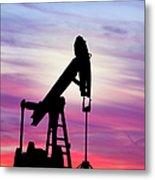 Dawn Over Gasoline Pump Metal Print