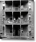 Family On Balcony Of Apartment Building Metal Print