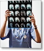 Female Doctor Holds Up Mri In Front Of Metal Print