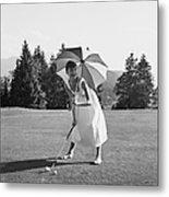 Golfing Hepburn Metal Print