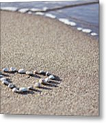 Heart Made Of Pebbles On Sand Metal Print