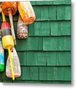 Lobster Buoys Hanging On A Green Wood Metal Print