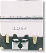Love Word In Capital Letters On A Typewriter Sheet Metal Print