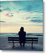 Man In Hood Sitting On A Lonely Bench On The Beach Metal Print