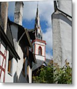 old historic church spire and houses in Ediger Germany Metal Print