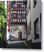 old historic street and woodframed house in Ediger Germany Metal Print