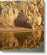 Reflection In Water Of Eroding Cliff Metal Print