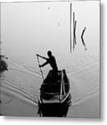 Silhouette Of A Boatman Rowing A Metal Print