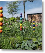 Sticks With Colorful Balls In A Garden Metal Print