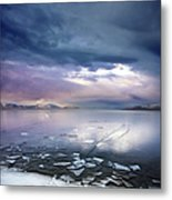 Storm Clouds Clearing Over Icy Lake Metal Print