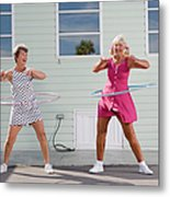 Two Senior Women Playing With Plastic Metal Print