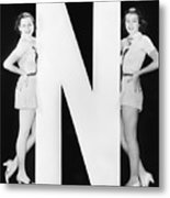 Two Women With Huge Letter N Metal Print