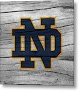 University Of Notre Dame Fighting Irish Logo On Rustic Wood Metal Print