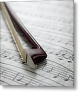 Violin Bow On Music Sheet Metal Print