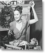 Woman Wrapping Christmas Presents In Metal Print