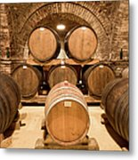 Wooden Barrels In Wine Cellar Metal Print