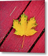 Yellow Maple Leaf Against A Red Deck Metal Print